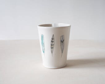 porcelain tumbler with feathers