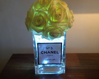 Chanel inspired vase with roses and 20 led lights.