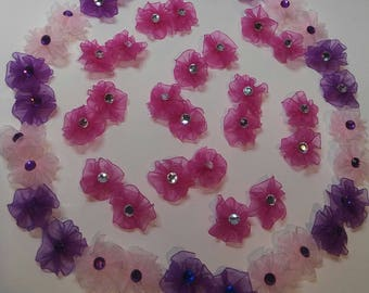 50 round dog grooming bows (pinks and purple)