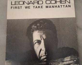 "Vinyl 45 laps Leonard Cohen ""First we take Manhattan"""