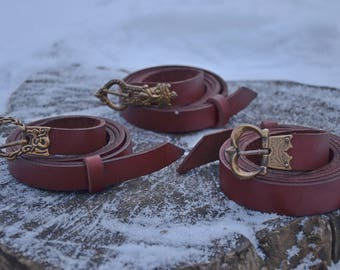 Belts with cast buckles.
