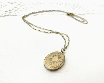 Antique brass locket, engraved keepsake locket