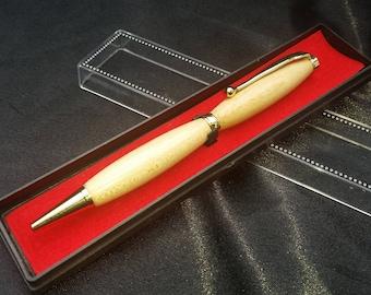 Hand turned wooden slimline twist pen, maple with gold trim