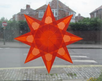 Orange kite paper window star