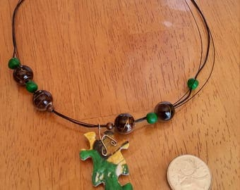 Green puzzle necklace