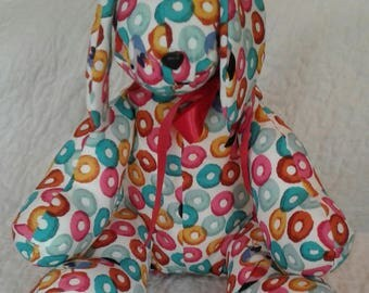 "Stuffed dog with ""Froot Loops"" pattern.  Adorable!"