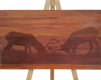 Two stags clashing, carved on recycled rimu, wall art
