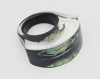 Black lucite ring with real glowing insect