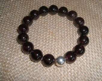 Garnet and sterling stretch bracelet
