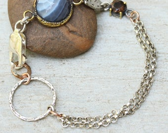 Round agate bracelet in brass bezel setting with round smoky quartz secondary gemstone and oxidized sterling silver double chain