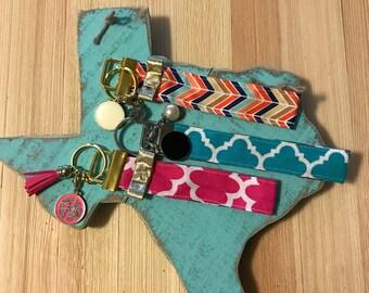 Monogram fabric key fob, wristlet, keychain