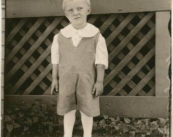 vintage photo 1920 Boy Winces Why Do I have to Wear this Outfit?