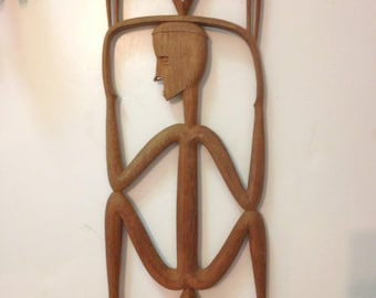 Wood sculpture  from Kenya man holding basket Vintage 70s
