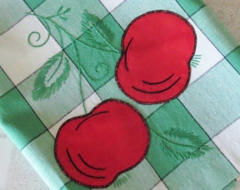 Ripe tomatoes appliqued on a checkered dish cloth, tea towel