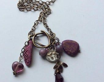 On Sale Amethyst purple charm medley necklace.Ceramic,wood, crystal,peruvian opal beads.