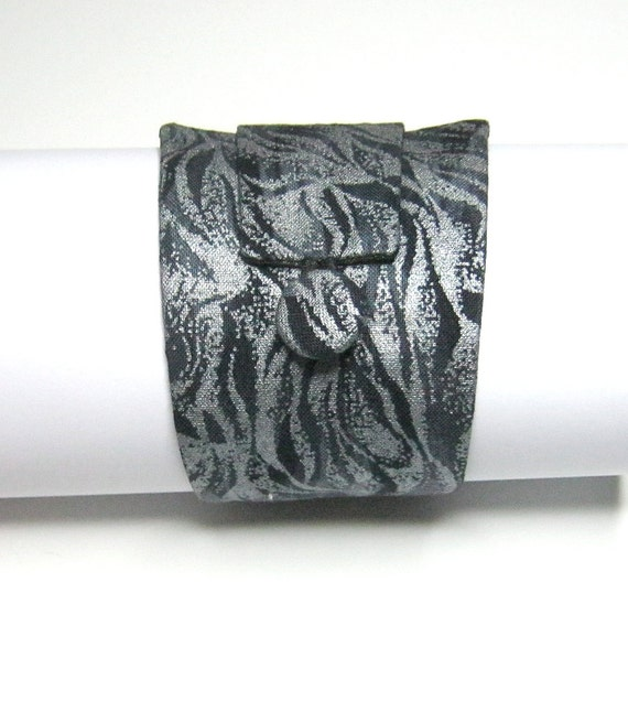 FABRIC CUFF BRACELET: In steely flame fabric, with self covered button. Large. Hand sewn.