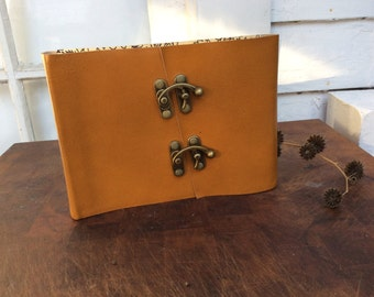 Photo album Beautiful mustard yellow Leather Photo Album with double latch. Holds 30 or 60 Photos and includes photo corners.