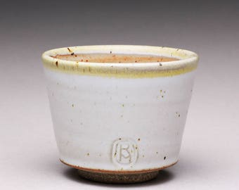 handmade pottery cup, ceramic teacup, yunomi with satin white and light orange shino glazes