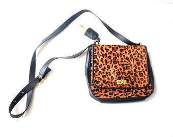 Classy vintage 90s black genuine leather, messenger, satchel, cross  body bag with  animal fur accent. Made by Fossil.