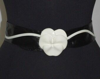 1980s Black Leather Belt, White Trimmed Belt, White Orchid Clasp, Adjustable Belt, Nan Lewis Belt, Black and White Belt, Black Fashion Belt