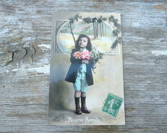 Vintage 1900s recolored French postcard  adorable boy  with a bouquet