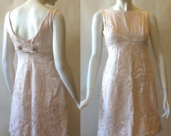 MOVING 4 GRADSCHOOL SALE 1960's brocade mini dress, in palest champagne pink with double rhinestone button back, pineapple pattern, sleevele