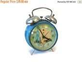 Antique wind-up animated alarm clock -  Illustrated dial - Birds - Nest - 1930s to 1940s
