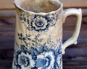 Antique Flow Blue Pottery Pitcher