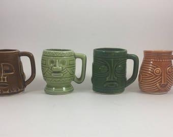 4 vintage Tiki shot glasses or toothpick holders