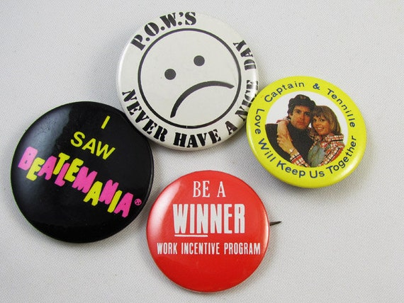 Lot of 4 vintage pin back buttons Captain and Tennille fan club / POW's never have a nice day /  be a winner / I saw Beatlemania / 1970s