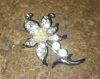 Flower Brooch with Faux Diamonds and Green Gem