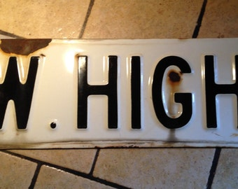 W. High Enamel Street Sign