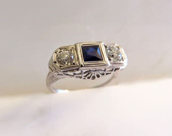 Circa 1930's 18kt White Gold Filigree Ring Set with Synthetic Blue Sapphire and Old European cut Diamonds.