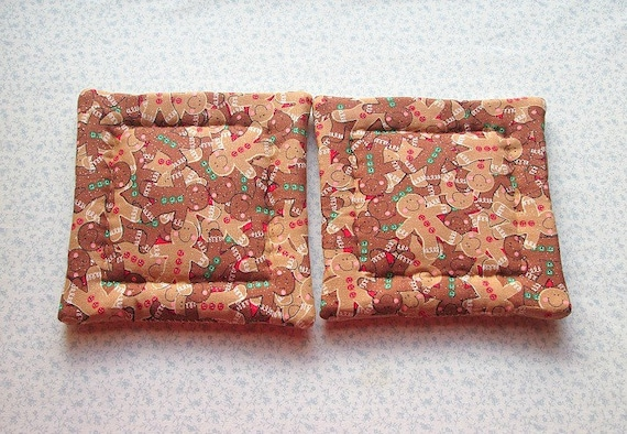 brown with a touch of glitter gingerbread man hand quilted set of 2 potholders hot pads
