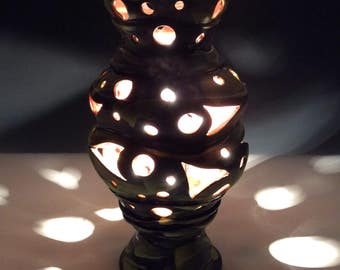 Yellow and black lamp with cutout circles and triangles