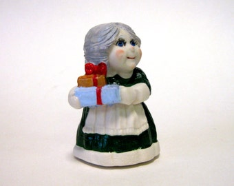 "Penny doll 3"" porcelain Mrs. Santa with presents"