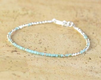 Tiny turquoise and sterling silver beads  bracelet.