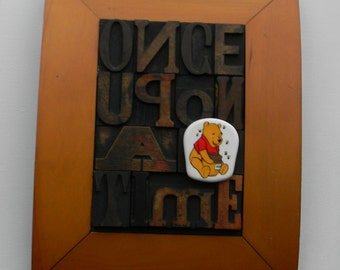 Once upon a time. Collage / quotation of vintage letterpress wooden printing blocks.