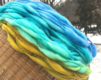 Handspun yarn, 36 yards and 1.9 ounces, 55 grams, spun self striping and thick and thin in hand dyed merino wool