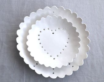 PEACE AND LOVE porcelain wall art. Set of two white ceramic plates scalloped edges geometric hole design white glaze porcelain fruit bowls