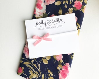 Navy and pink floral swaddle blanket with velvet pink bow set