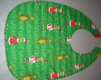 Grinch on green fabric-  Adult Size Bib / Clothing Protector - Reversible
