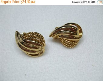 SALE 50% OFF Vintage Knot Gold tone clip earrings Signed Chr. Dior