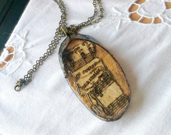 Music Necklace, Woodburned pendant, decoupaged live edge birch wood slice, vintage classical sheet music, aged and distressed, brass chain