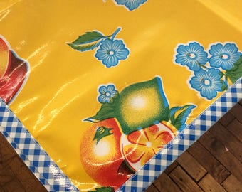 48x48 Sliced Fruit Yellow Oilcloth Tablecloth with Blue Gingham Trim