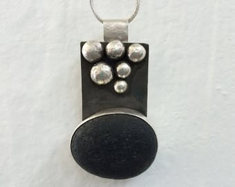 Sterling silver pendant with black Icelandic lava stone and six silver pebbles