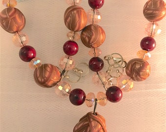 Tri-Beaded Hand Strung Necklace:  Red Stone, Faceted Crystal and Polymer Clay Handmade Beads with Adornment in Center