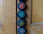 Small colorful felt door hanger