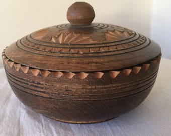 A pretty, vintage carved wooden pot with lid.