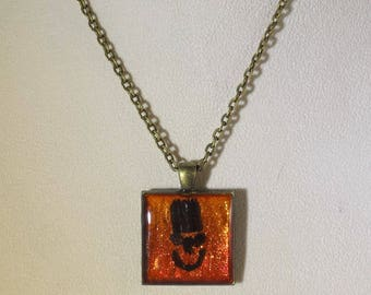 Holographic Glowing Orange Flat Top Grin Hand Layered Desert Smiling Face Upcycled Reclaimed Treasures Resin Pendant